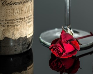 Bottle of wine and rose